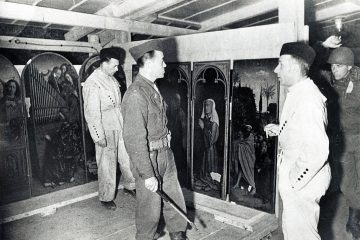 Monuments men looking at art found in the Altaussee salt mine during WWII