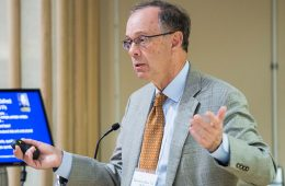 Dr. Theodore Bass '72 stands at podium delivering 2017 Wolk Conference keynote