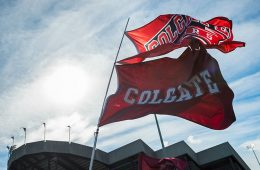 Colgate and Raider athletics flags fly beside Andy Kerr Stadium