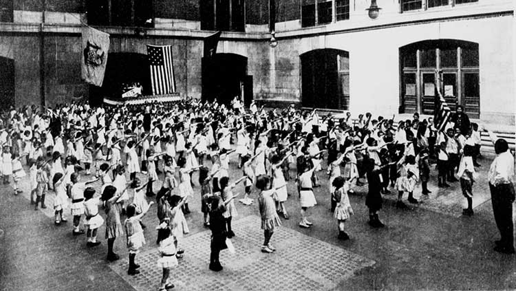 American children performing the original correct American flag salute in 1915