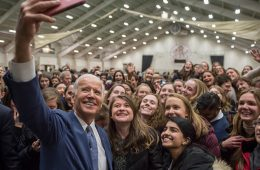 Former Vice President Joe Biden takes a photos with students during a 2017 visit to Colgate University.