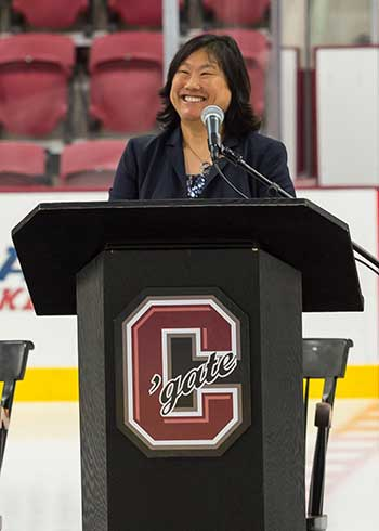 Victoria Chun '91, MA'94 stands at podium in Class of 1965 Arena