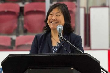 Vicky Chun '91, MA'94 stands at podium