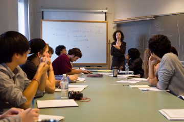 Valerie Morkevicius teaches at the front of a seminar room