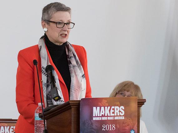 Professor Ellen Kraly at the podium