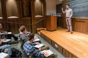 Sam Rosenfeld, assistant professor of political science, teaches a political science course in Lawrence Hall, March 26, 2018.