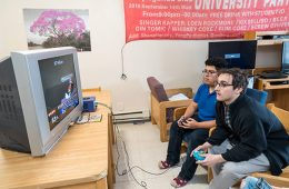 Two Colgate students play a video game