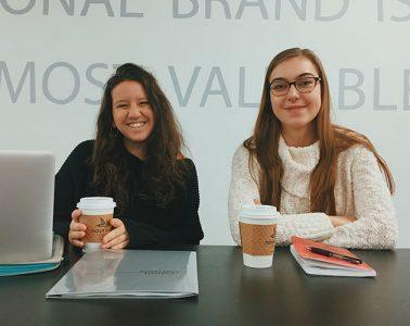 Two Colgate student entrepreneurs at a desk