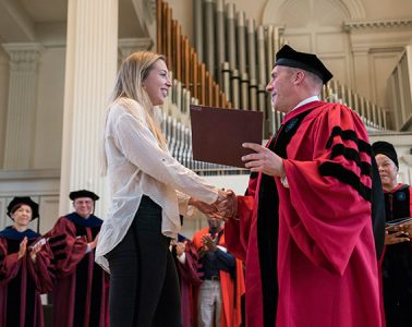 Colgate's 1819 Award winner receives the award from Colgate President Brian W. Casey in the Colgate Memorial Chapel.