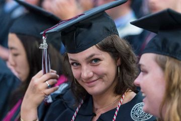 A student moves her tassel at the 2018 commencement ceremony