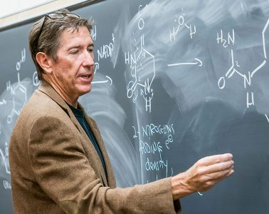 Chemistry professor Ernie Nolen at the chalkboard