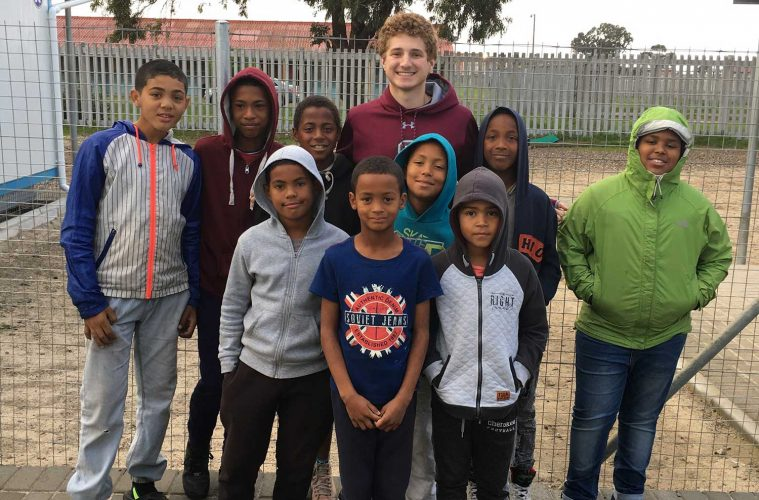 Brady Pearlstein '21 with students in South Africa