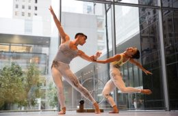 Two dancers pose during their dance of modern art