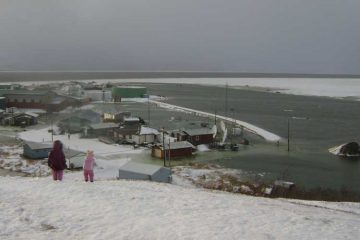 Ocean waters encroach on buildings in Golovin, Alaska