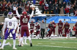 Head Football Coach Dan Hunt and the Raiders football team celebrates a last-minute NCAA playoff victory over James Madison on December 1, 2018.