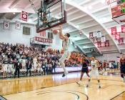 Colgate player slam dunks