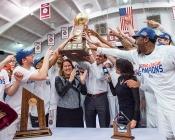 Colgate coaches and players lift Patriot League trophy