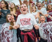Group of young Colgate fans cheer on team