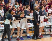 Colgate bench and coaches look on in anticipation of victory