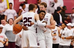Jordan Burns '21 celebrates on the court with teammates