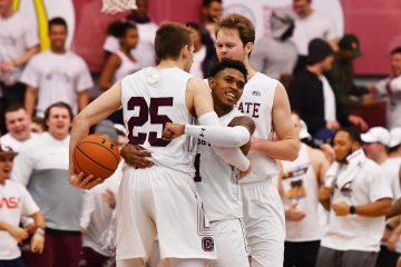 Jordan Burns '21 celebrates on the court with teammates