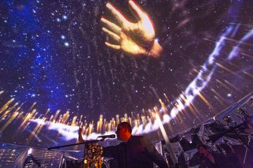 Image of golden hand and stars on the vis lab dome