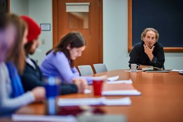 Peter Balakian, Donald M. and Constance H. Rebar Professor in humanities and professor of English, sits at a table with students