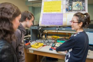 Alina Sabyr '19, right, astronomy and physics major, talks with other students during Electronics Presentations: Digital Arcade at the Robert H.N. Ho Science Center.