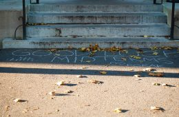 """Good luck with midterms"" chalked on steps of academic building by DoRAK members"