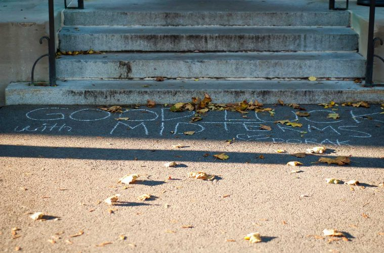 """""""Good luck with midterms"""" chalked on steps of academic building by DoRAK members"""