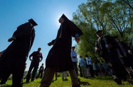 Seniors walk toward commencement stage