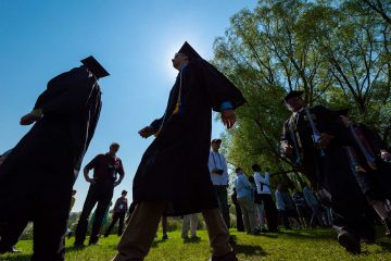 Seniors walk toward commencement stage
