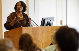 Professor Dianne Stewart '90 lectures from a podium