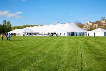 A large white tent on a very green Whitnall Field